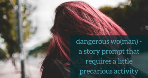 """A woman with red hair walking down a busy street with the overlay """" dangerous woman - a story prompt that requires a little precarious activity"""